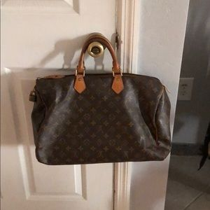 Authentic Louis Vuitton Carry All. 14x15.